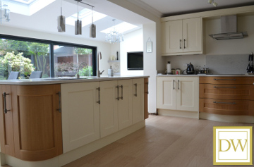 This Shaker style kitchen has a modern twist in cream and oak with Silestone worktops & hot water tap..