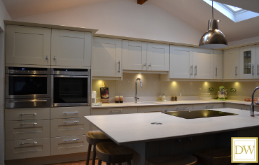 Shaker style oak kitchen painted in stone and almond with Dekton (by #Silestone) worktops & glass splash-backs..