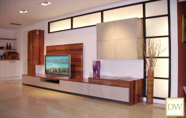Bespoke contemporary TV media unit with modular wall cupboards and drawers.