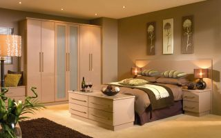 The sleek coffee coloured High Gloss doors create a distinctive, cosmopolitan feel.   With matching bedside chests, headboard and bed trunk/drawers an incredibly stylish, calm yet warm bedroom design is achieved.