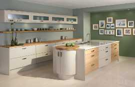 A modern kitchen with cool, clean and unfussy  lines, painted in 'clay' and mixed with oak