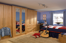 Warm tones of birch chosen for a boys bedroom . Full length central mirrors are attractive yet practical; lots of future-proof storage, and a desk area  - a great idea for encouraging homework!