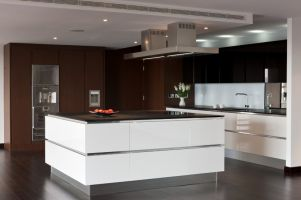 Contemporary white & chocolate creates a dream designer kitchen that is both spectacular and efficient.