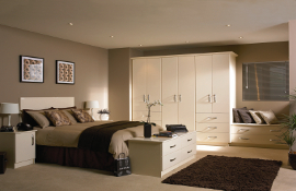 Cream gloss will always be a winner for a contemporary bedroom design.  The smooth, streamline robes and feature drawers incorporating window seat together with drawers at the bottom of the bed gives a bright and airy feel and provides ample, usable storage.