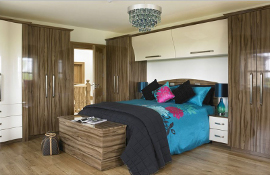 High gloss fitted bedroom furniture in Ttielopo mixed with Cream  giving a modern twist to a classic design.