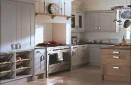 A farmhouse style kitchen designed for comfortable family living. This simple, no fuss, classic, shaker kitchen design features an up-dated larder cupboard and has been mixed with an oak island to add interest.