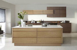 Right on trend is this beautiful oak veneer handle-less contemporary kitchen.
