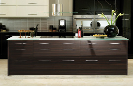 Pan drawers are currently very popular  and a feature of this ebony and cream contemporary kitchen.