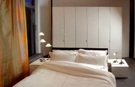 White bedroom units in solid acrylic provide a simple stylish contemporary  look.
