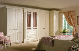 A  French style bedroom  complete with beautiful fluted rail cornice, reeded pilasters and fretted frames .  Simple and sophisticated  chic.