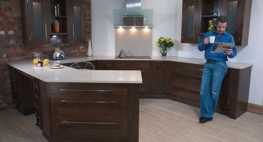 Crisp, sleek, shaker- style contemporary kitchen in solid walnut; a wood that exudes quality and warmth. Complimented perfectly with minimal shaker style handles.