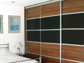For an individual contemporary stylish look - 5 panels with aluminium trim in a mix of walnut and black glass.