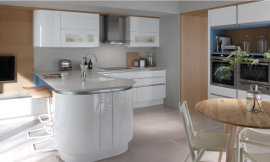 Curvaceous hi-gloss white kitchen with aluminium rails and grey worktops complete this sleek contemporary look.