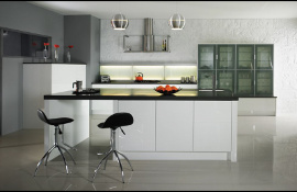 Glass door dresser, Midi units and feature wall lighting all add interest to this ultra white contemporary kitchen.