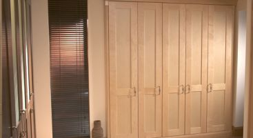 A simple, no-fuss, run of wardrobe doors in natural oak timber - practical and timeless ; the warmth of the grain will continue to show through as time goes by.
