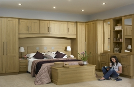 Great idea for the teenage - this classic modern light oak shaker bedroom design uses  all available space to great effect.