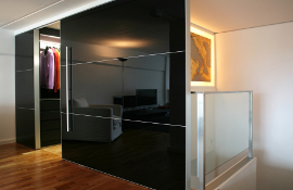 Quality sliding doors in solid acylic giving a clean minimalist look -  also available in glass.