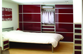 'Bordeaux' burgandy glass sliding doors with matching drawer fronts and aluminium trim.