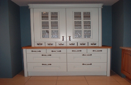 Painted made-to-measure dresser shown here in duck egg blue with feature glass wall cupboard and spice drawers provides convenient storage as well as an attractive display solution. Solid medium oak top and pewter handles complete the look. A great standalone showpiece for your kitchen.