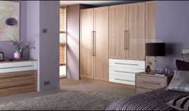 A really fresh modern look is this light oak with cream fitted bedroom furniture.