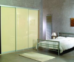 Full length glass sliding doors shown here in primrose yellow with aluminium trim.